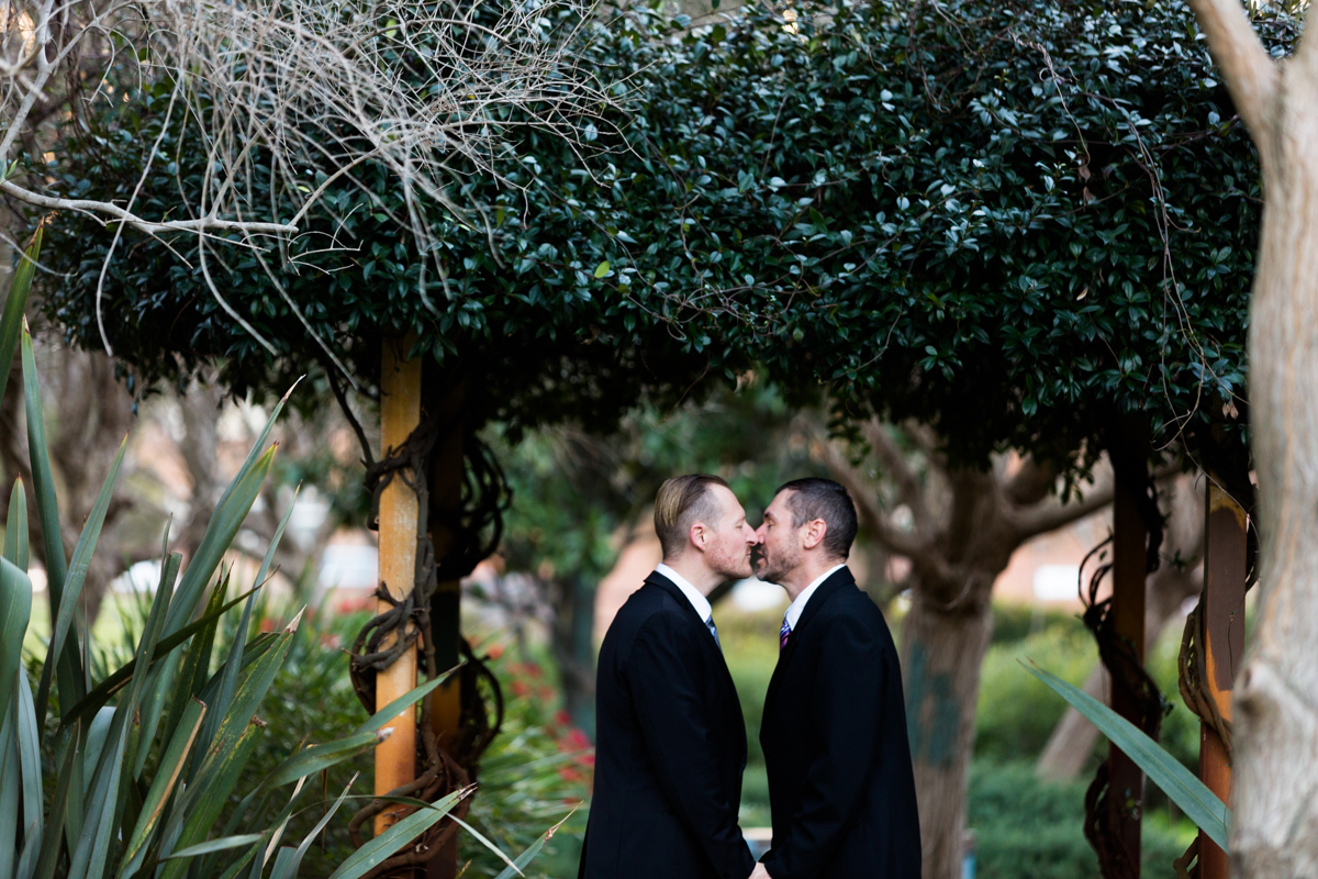 021_the best wedding photographer in newcastle photographs kiss shared by gay couple