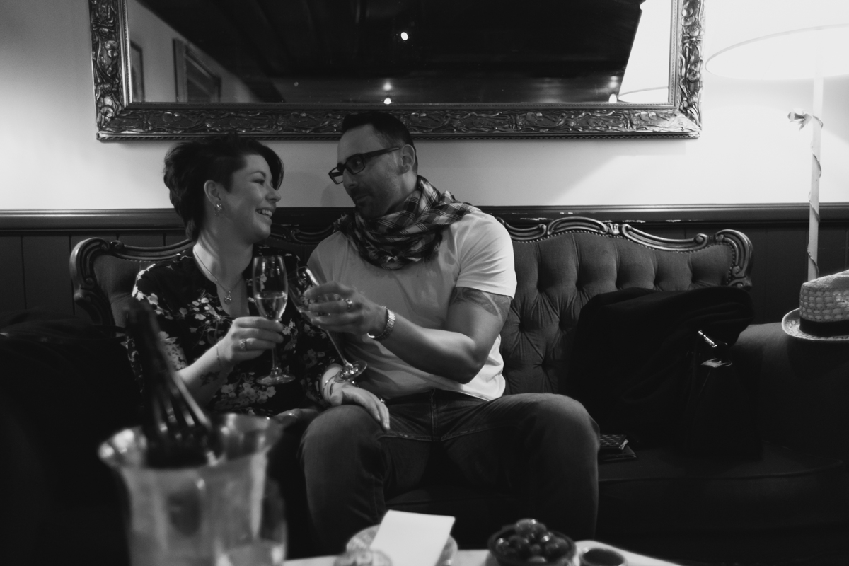 14_Newly engaged couple celebrate at Bar Petit after surprise engagement photography