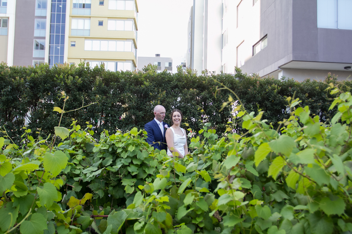 19_bride and groom in urban setting in honeysuckle