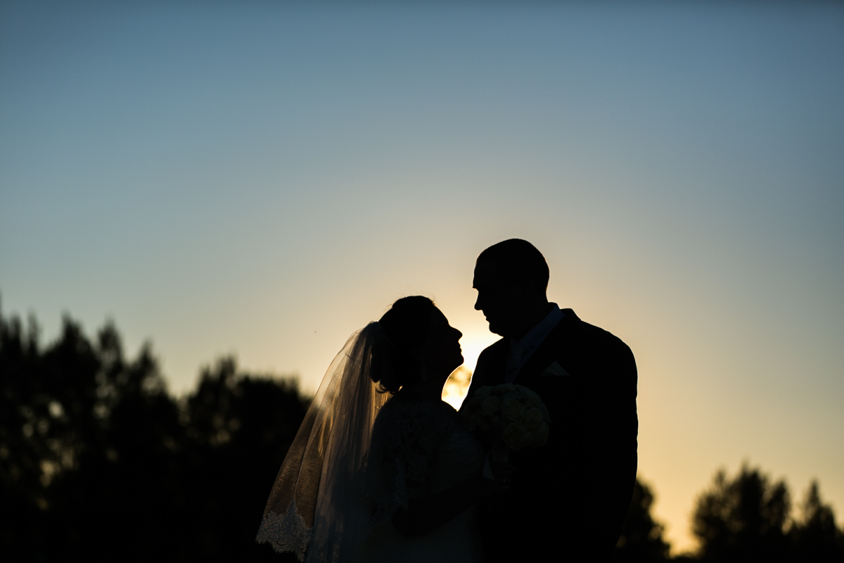 30_silhouette of newly wed bride and groom